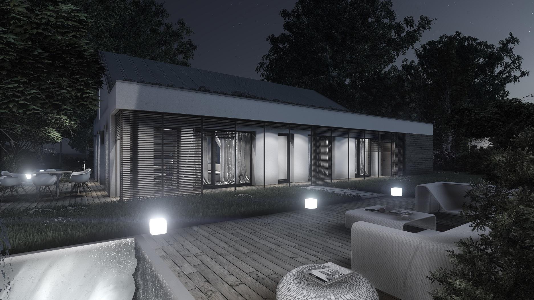 Projekt domu pasywnego DAS HAUS I Domy Czystej Energii widok od ogrodu nocą